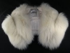 """a couple of stories about furs: 1) i have a white mink stole from a family friend of ours, who bought it, along with a round the world cruise ticket, when her husband died. because """"that's what you do,"""" she said.      2) one of my grandmother's sisters was thought to be snooty because she wore her fur stole to church. oh! how audacious! said the ladies of the village. as the youngest sister, she had an eye for the finer things in life, or """"an eye for the flash"""" as it is remembered in family…"""