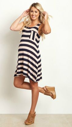 Keep cool in casual style with this season's new favorite striped pocket front tank dress. Its flowy and oh-so breezy design will flatter your figure while keeping you comfortable from morning to night. Easily transitioned from one event to the next with a quick change of accessory, your summer wardrobe would be incomplete without it!