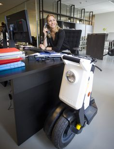 GiGi foldable electric scooter. Your scooter safely stored and charged at workplace