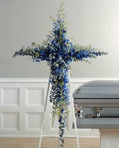 Beautiful floral cross funeral arrangement made using blue delphinium. Perfect for his funeral or memorial service. Flowers Wallpaper, Wallpaper Art, Casket Flowers, Funeral Floral Arrangements, Flowers For Men, Funeral Sprays, Casket Sprays, Blue Delphinium, Funeral Tributes