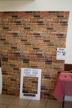 Harry Potter photo booth setup with a brick paper background from Hobby Lobby