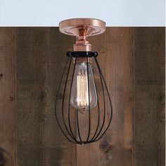 With a clean and simple design, the Abuja Flush Ceiling Light will add a contemporary touch to your home. This industrial cage ceiling light provides an elegantly simple central lighting source perfect for dining rooms, seating areas or bedrooms. Designed to showcase the warmth of Edison-style filament bulbs, this ceiling light fixture features an adjustable wire cage that can be altered easily to your own preference