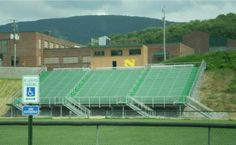 Situation: Narrows High School in Narrows, Virginia needed a new 1250 seat grandstand for their sports facility. The grandstands were to be constructed on a steep hill side with a 2:1 slope with approximately 20'-0 of soft fill soils. The steep slope of the hill made it difficult to use and maneuver heavy equipment required with other deep foundation systems.  Ram Jack was added to the design team to provide a solution that would handle the design loads, be fast, efficient and long lasting.