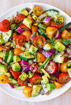Tomato, Cucumber and Avocado Pesto Salad.