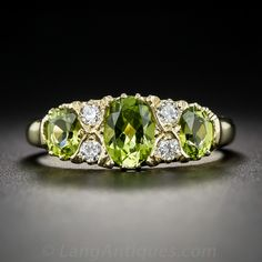 English Peridot and Diamond Victorian Style Ring. Newly made in London, England in enduring Victorian style, this cheerful charmer wraps your finger with a trio of bright and lively, lime green peridots punctuated in between with sparkling pairs of new European-cut diamonds. Crafted in rich 18K yellow gold with hallmarks inside