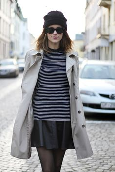 leather skirt and stripe tee with a trench