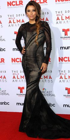 At the 2013 NCLR ALMA Awards, Eva Longoria slinked onto the red carpet in a long-sleeve onyx burn-out velvet Romona Keveza mermaid gown with...