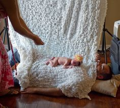 That's one way to keep a baby calm for photos…