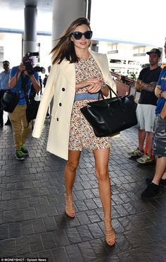 Airport chic: Miranda Kerr stepped off a runway on a different kind on Monday, and looked just as chic as she would have if she had starred in a high end fashion show as she arrived at LAX