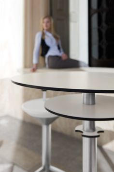Minimalist table composed of 3 superimposed tops which form a cone shape.. design Itamar Harari 2008. Compact grade laminate tops, painted steel structure with non-scratch finish!