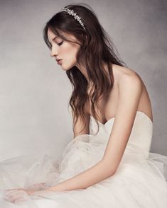 Worn casually with a modern gown or as a complement to a formal dress, a jeweled headband can elevate a bride's look from classic to regal. The Crystal Flower Headband features delicate floral beading, perfect for a daytime or evening wedding. Shop for more bridal hair accessories from WHITE x Vera Wang by tapping the link in our bio. #WHITExVeraWang  #DavidsBridal