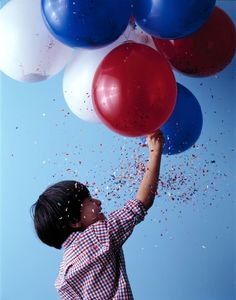 """If your state has consumer fireworks restrictions or completely bans them (ahem: Delaware, Massachusetts and New Jersey), or you simply don't have an outdoor space appropriate for party poppers and Roman candles, fill balloons with red, white and blue confetti instead.  """"Confetti-filled balloons are a fun alternative to fireworks,"""" says Stewart. """"Satisfyingly loud and sparkly, they can be set off by kids indoors. To make, pull a balloon over a funnel, pour in the confetti until the balloon…"""