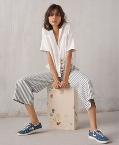 madewell white cotton courier shirt worn with emmett wide-leg crop pants + tretorn sneakers.