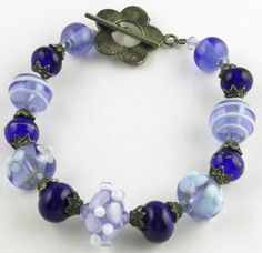 Blue, White, Clear bracelet made with Lampwork Glass beads