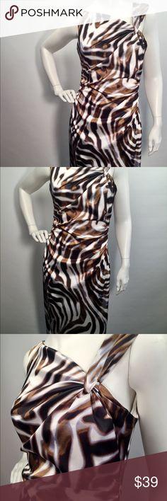 Maggy L animal print chic dress Sz 6 Super cute animal print dress Sz 6 barely used. Back zipper Excellent Condition Maggy L Dresses Midi