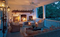 amazing porch with seating and fireplace