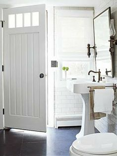 Great bathroom. Love  that door!