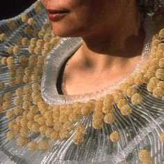 Nora Fok: Wearable and fully functional abacus. Knitted Neckpiece
