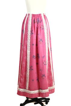 1970s patchwork skirt in a cotton blend of various pink fabrics. Alternating strips of pattern. Elastic waist and maxi length. Fully lined in soft cotton. Fun and flowy boho prairie skirt. . M E A S U R E M E N T S . w a i s t : up to 32 h i p : up to 44 g a r m e n t . l e n g t h : 40 For more information on measurements, visit: http://www.foxburrowvintage.com/p/measuring-vintage-clothes.html . C O N D I T I O N . e x c e l l e n t : Barely used, no visible flaws. ....