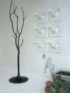 Ghost Tree Coat Rack by Erich Ginder and antlers hooks