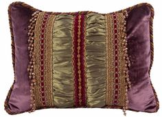 This Purple and Green Velvet Decorative Rectangle Pillow is the perfect size to tuck into any pillow collection. The beads, decorative border trims and cording finish it off perfectly!