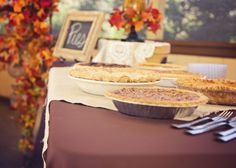 "What says ""Fall"" more than fresh baked pies. Pie Table Outdoor Fall Wedding"
