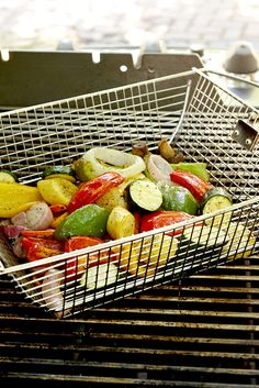 Instead of skewers, another of the pro's go-to grilling techniques for grilled veggies is in large batches in a grill pan. (And it's quicker than skewering all of them.) #grillingtips #summergrilling #bbqtips #grillinghacks #bhg