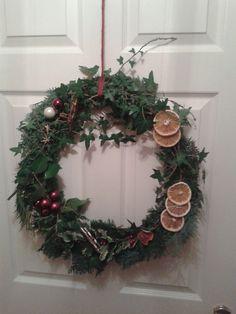 I made this using Willow as the base. Christmas Wreath with orange lemon and cinamon. Christmas Wreaths, Lemon, Base, Orange, Holiday Decor, Happy, Home Decor, Decoration Home, Room Decor