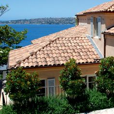 Terracotta roof tiles and grey solver beaver walls for Spanish style roof shingles