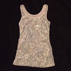 Tank Top Sparkling Silver Tank Top. Great under a nice sports, suit or denim jacket. Very comfortable too. I'm sure you can wear it well. Old Navy Tops Tank Tops