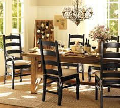 Wynn Ladder Back Chair from Pottery Barn. Love the black chairs with rustic wood table.
