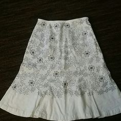 Embroidered Skirt Embroidered skirt with side zipper. Body if skirt is 55% linen 42% rayon 3% spandex Embroidery 100% polyester. Dialogue Skirts
