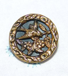 Charming Antique Open Work Brass Picture Button ~ Bird in a Tree with Flowers ~ by YesterYearsFindings on Etsy https://www.etsy.com/listing/255920895/charming-antique-open-work-brass-picture