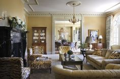 Beautiful traditional living room with a pop of tiger print - so fun!
