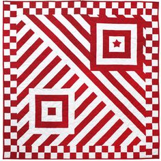 Red-and-white striped fabric is used for the entire quilt, including the…