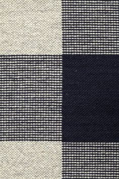 Foster in Midnight - Undyed Light Gray and Thin Felted Midnight - Customizable with all yarn colors. Foster is a tonal interplay of toothy weaves in an elegant gingham check pattern. A flatweave rug made from undyed heathered and felted wools, Foster is available in 3 rich colorways: Black, Midnight and Wisteria. The last mill built during Fall River's textile boom, The Foster Spinning Company was added to the National Register of Historic Places in 1983.