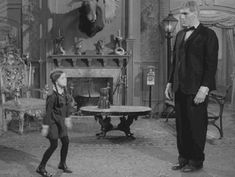 "Characters Wednesday Addams and Lurch from ""The Addams Family"" TV show of the 60's"