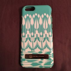 Trina Turk iPhone 6/6s case Bohemian Trina Turk iPhone 6/6s case. Hard plastic backing with soft rubber lining. Metal plate on back has some scratches but in good condition. Trina Turk Accessories Phone Cases
