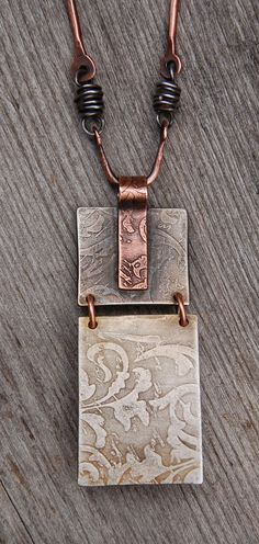 back of jasper pendant with etched silver nickel and etched copper bail  love the joiner rings