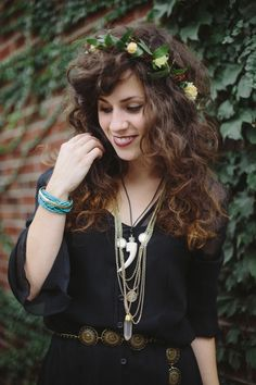 Nice layering of accessories over a peasant-style top. Also her hair is perfect.