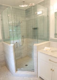 Serene Bathroom.  Carrerra Marble and subway glass tiles on wall.