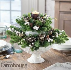"""From dazzling centerpieces to themed place settings, creative designs like this milk-glass centerpiece will ensure your table gets all the attention it deserves! To see more great ideas, check out the """"Festive Table Embellishments"""" article in our holiday 2020 issue. Banquet Table Decorations, Banquet Tables, Christmas Table Decorations, Handmade Decorations, Glass Centerpieces, Holiday Centerpieces, The Night Before Christmas, All Things Christmas, Country Sampler"""