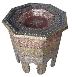 """Antlia Moroccan Table by Star of Morocco. $479.00. Dimensions: Height =21"""", Width = 18"""", Length = 21"""". Made of wood wrapped with hand-carved metal sheets of white brass, copper and brass. Center of table is decorated with leather. Authentic handmade Moroccan table. Authentic handmade Moroccan table. Table is made of wood and is wrapped with hand-carved metal sheets of white brass, copper and brass. Center of table is decorated with leather. Dimensions: Height =21"""",..."""