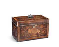 A George III mahogany, tulipwood banded, sycamore and harewood floral marquetry tea caddy in the manner of John Cobb