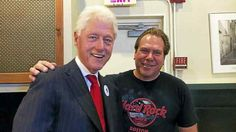 Clinton with Charles Pilotto of East Haven at Pepe's Thursday.