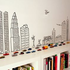 Great idea for a city skyline scene above a low book shelf. Could adapt this for other rooms (non-kid rooms).