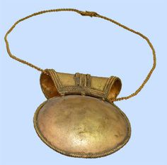 Roman bulla was a locket made from silver or gold, bronze or leather with charms against evil eye. Was placed around infants neck for protection
