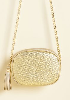 Weave an Impression Bag. With this gold purse over your shoulder, you liven up the networking event from the help of your bold accessorizing. #modcloth