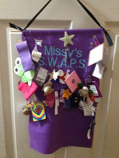 Girl Scout SWAPS holder - felt.  I like the shooting star swap pinned near the top