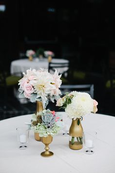 Gold spray painted glass vases and mason jars - Surprise california wedding | photo by Megan Welker | 100 Layer Cake